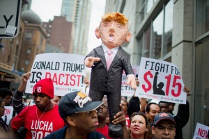 Activists Protest For Immigration Reform And Fair Wages At Trump Tower In Chicago