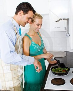 husband-teaching-wife-cooking-12836859