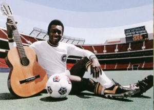 jugador en estadio con guitarra y balon